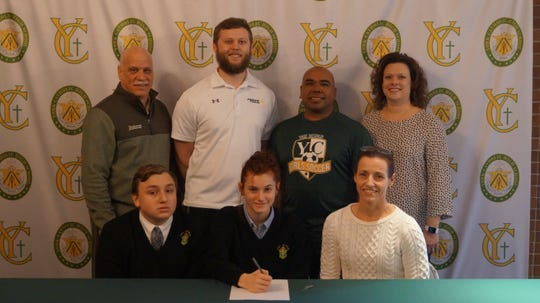 York Catholic senior Kylie Kemp signs her letter of intent to play soccer at Trinity Washington.