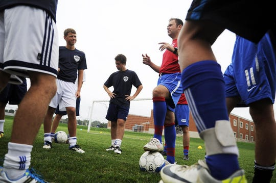 In this file photo, Steve Corrieri, right, talks with West York players during a soccer camp in 2012.