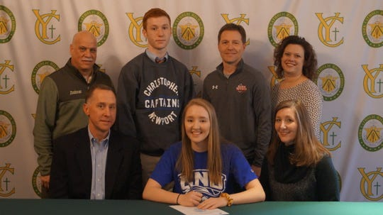 York Catholic senior Katy Rader signs her letter of intent to play basketball at Christopher Newport.