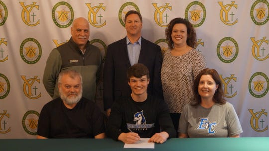 York Catholic senior Ethan Higgins signs his letter of intent to play soccer at Elizabethtown College.