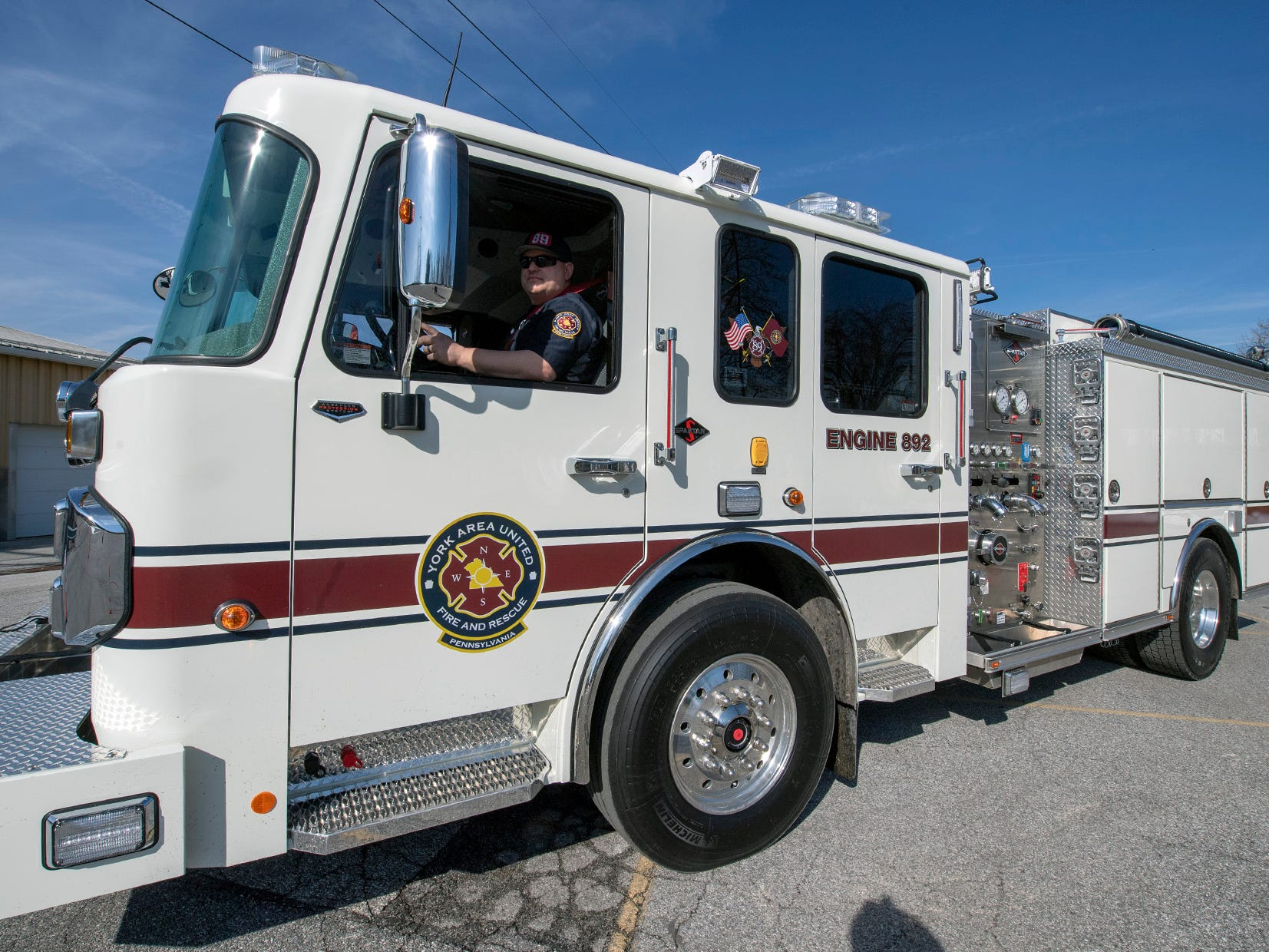 Firefighter Chuck Yingling takes Engine 892 through the slalom course during training at York Area United Fire & Rescue's Victory Fire Co. No. 2 in Spring Garden Township. The course includes backing the engine back though the course and parallel parking. All firefighters are trained to drive the engine.