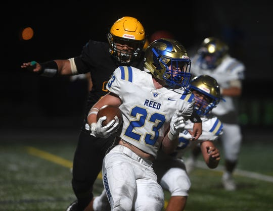 Reed's Champ Robertson (23) runs the ball against Bishop Manogue during their football game in Reno on Aug. 24, 2018.
