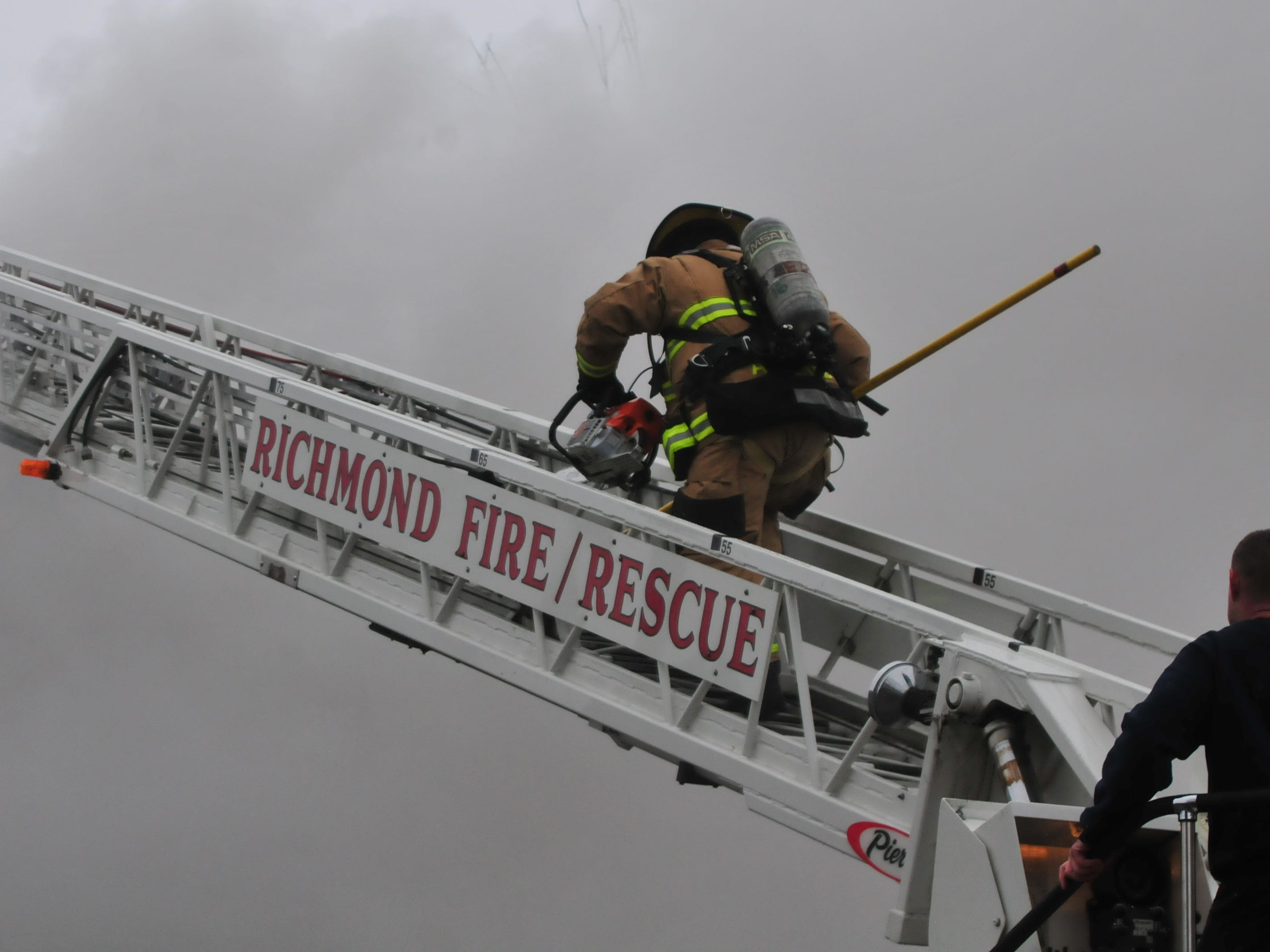 Richmond Fire Department personnel used an aerial ladder to access the roof while fighting a fire Wednesday at 112 N. 18th St.