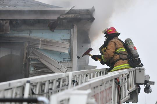 Richmond Fire Department personnel accessed the walls from the outside Wednesday during a fire at 112 N. 18th St.