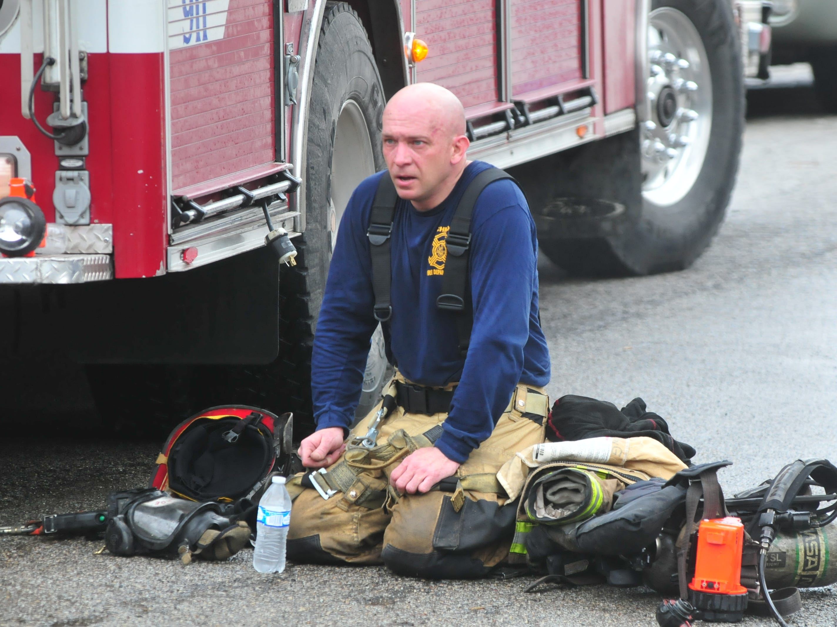 Lt. Kyle George rests between stints fighting a fire Wednesday at 112 N. 18th St.