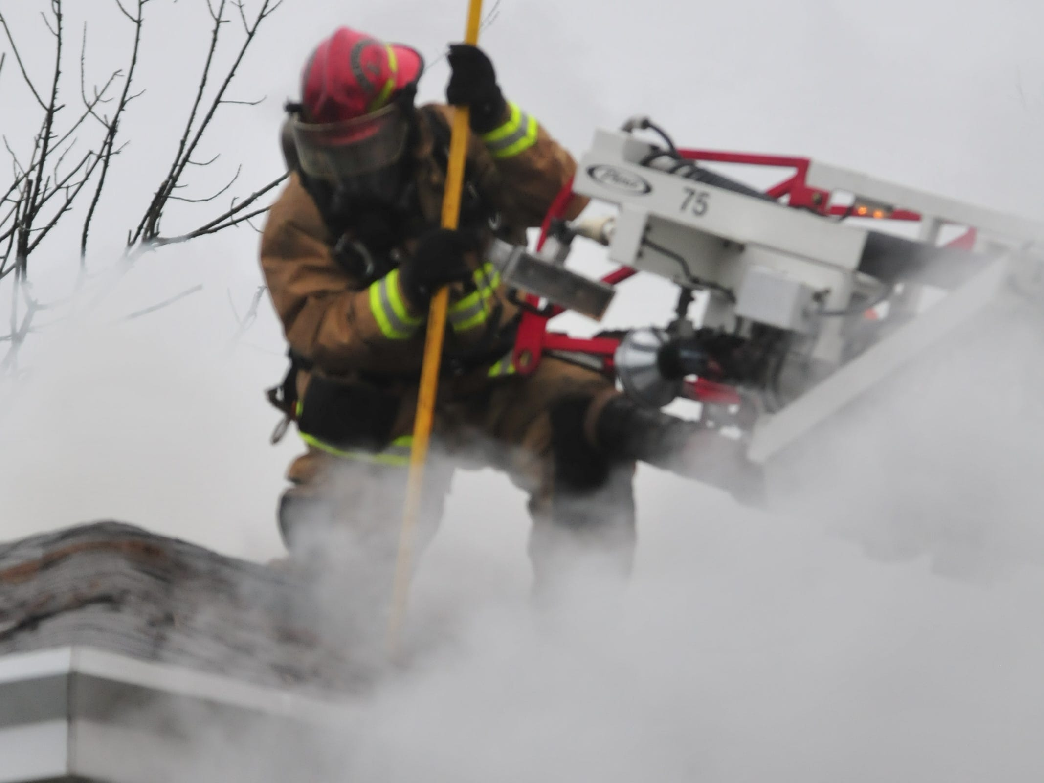 Richmond Fire Department personnel worked from the roof Wednesday during a fire at 112 N. 18th St.
