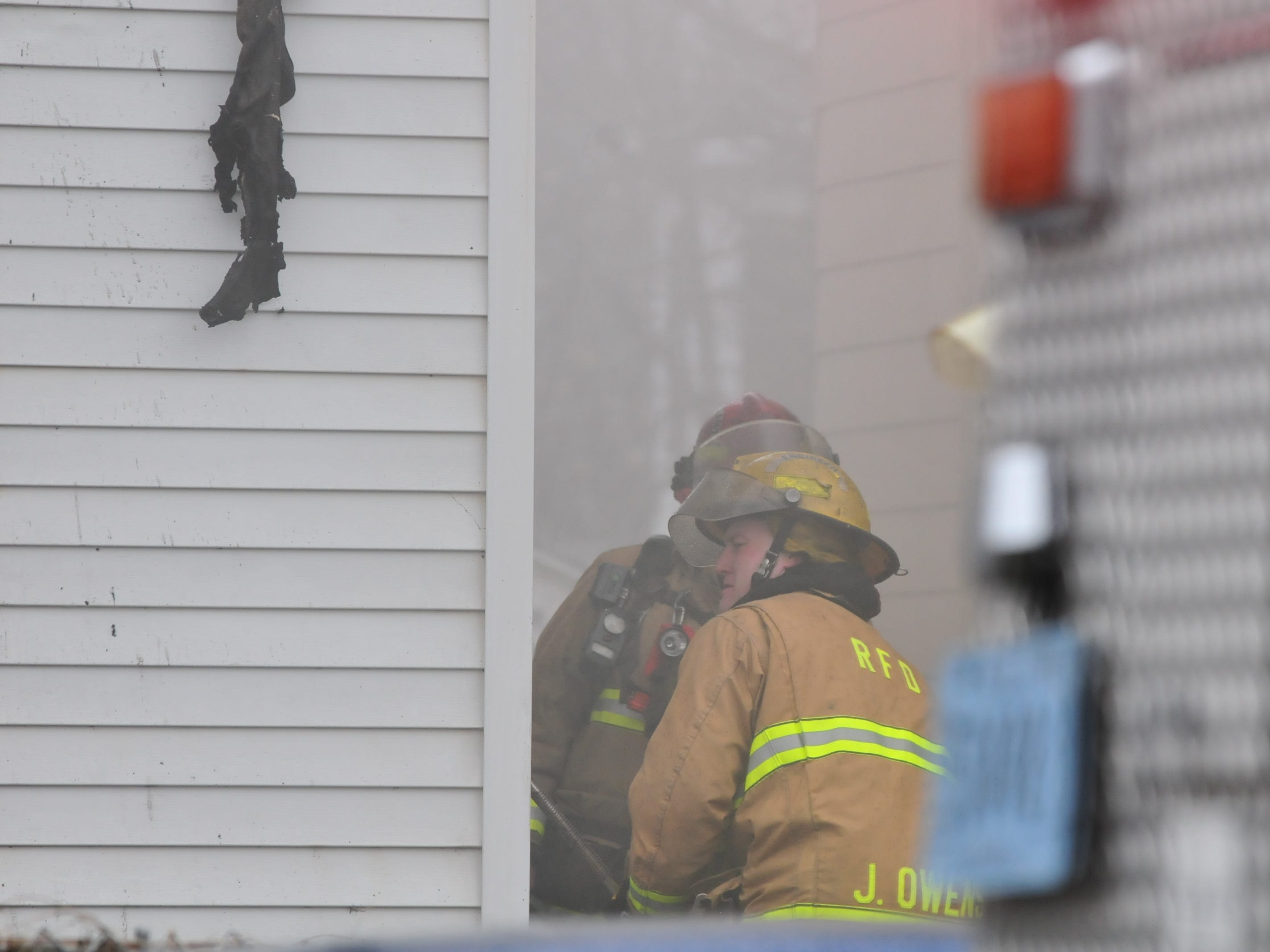 Richmond Fire Department personnel uses a crowbar on the side of 112 N. 18th St. during Wednesday's fire.