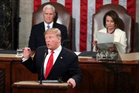 President Donald Trump delivers his State of the Union address to a joint session of Congress on Capitol Hill in Washington, as Vice President Mike Pence listens and Speaker of the House Nancy Pelosi, D-Calif., reads the speech, Tuesday, Feb. 5, 2019.