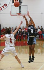 Kearney's Marianna Freeman, right, sinks a long three pointer over the defense of Penfield's Baylee Teal.