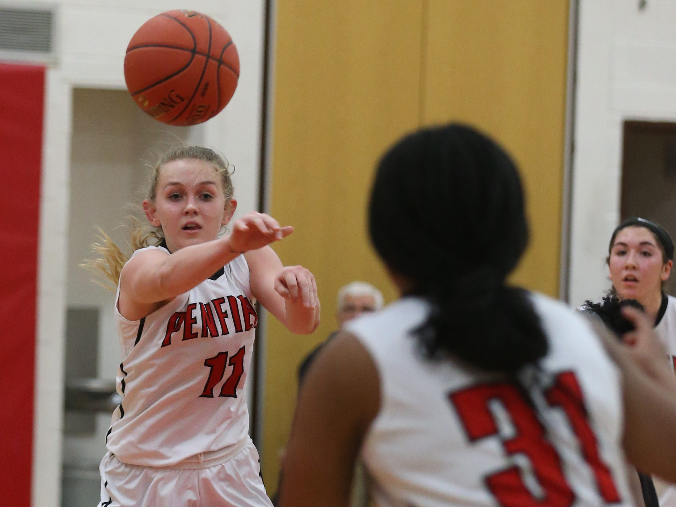 Penfield's Nina Nesselbush, left, zips a pass to teammate Nyara Simmons in the low post.