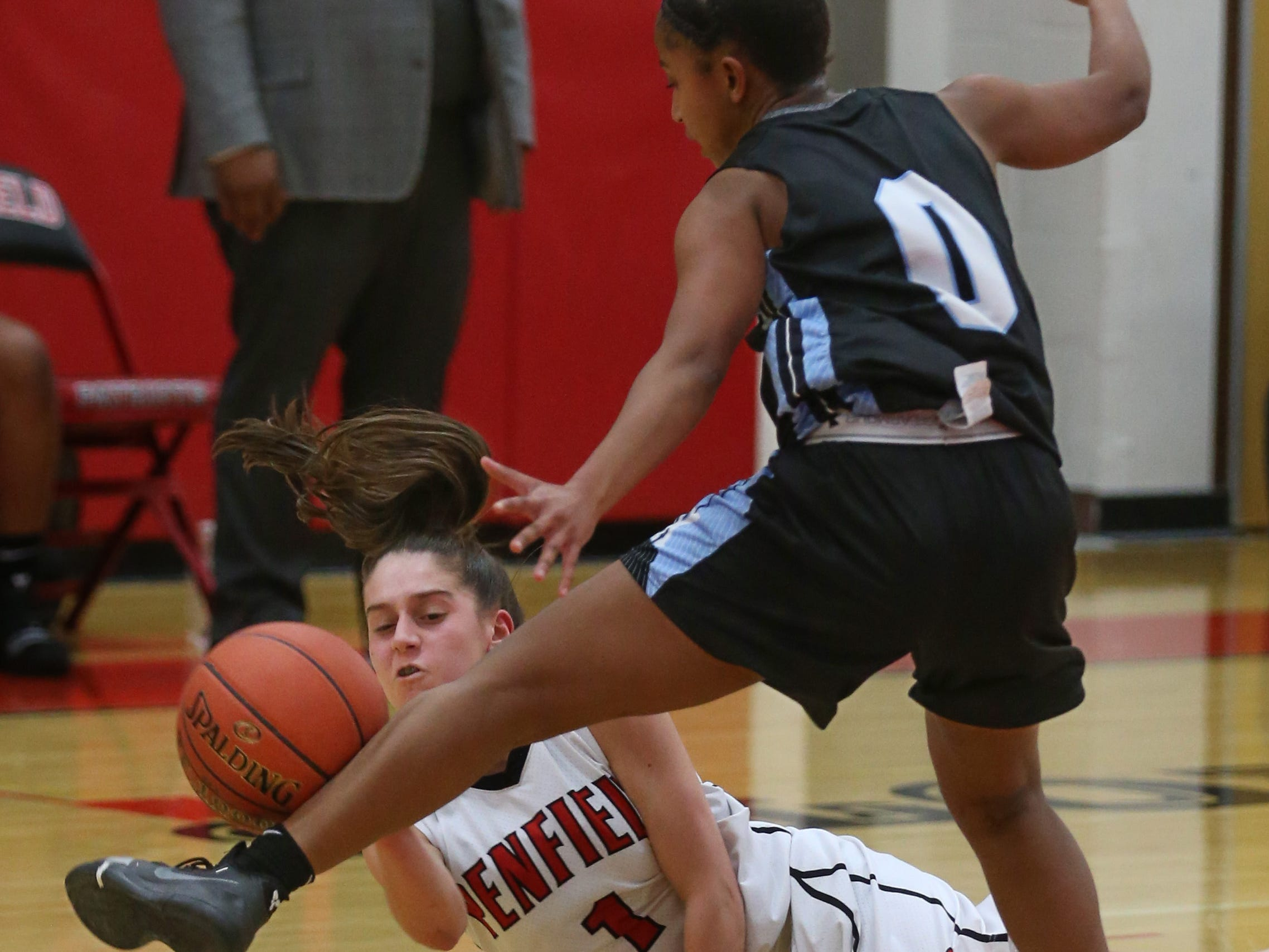 Penfield's Baylee Teal, bottom, steals the ball and has it knocked out of bounds off the leg of Kearney's Marianna Freeman.