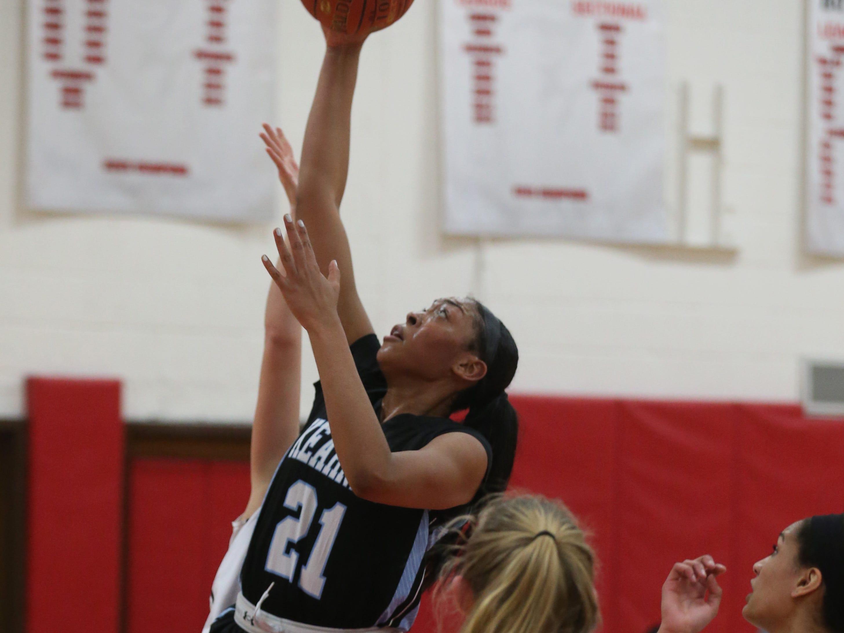 Kearney's Saniaa Wilson pulls down a defensive rebound.