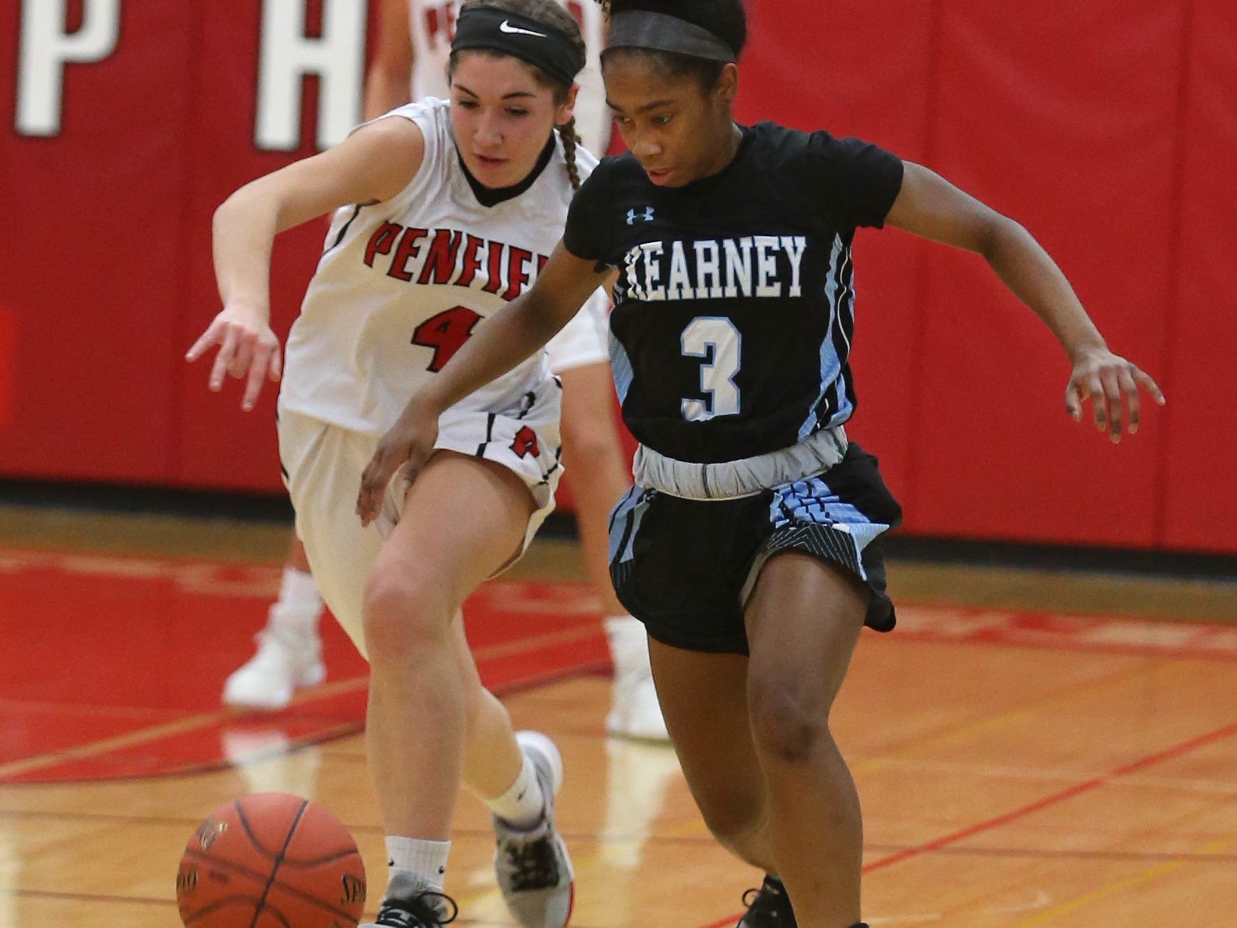 Bishop Kearney's Kaia Goode, right, outraces Penfield's Katie Rinere for a tipped ball during their game Tuesday, Fe. 5, at Penfield High School. Kearney won the matchup 64-51.