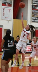 Penfield's Baylee Teal puts in a running shot in the lane over Kearney's Saniaa Wilson. Penfield and Bishop Kearney are the top two seeds for the Section V Class AA Tournament.