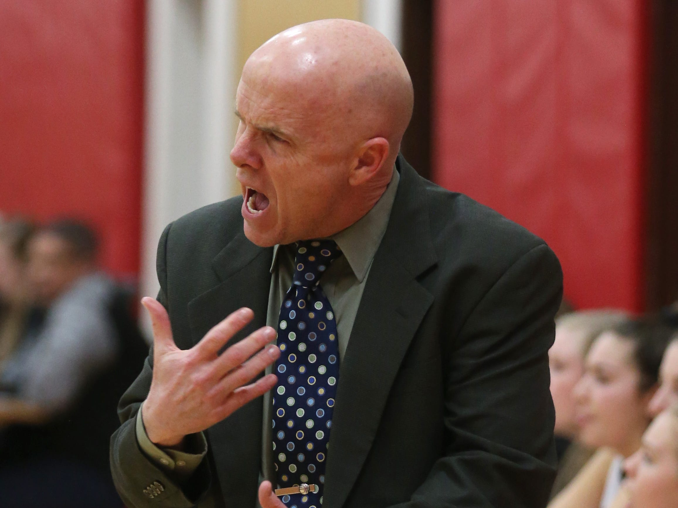 Penfield head coach Mark Vogt encourages tighter defense.