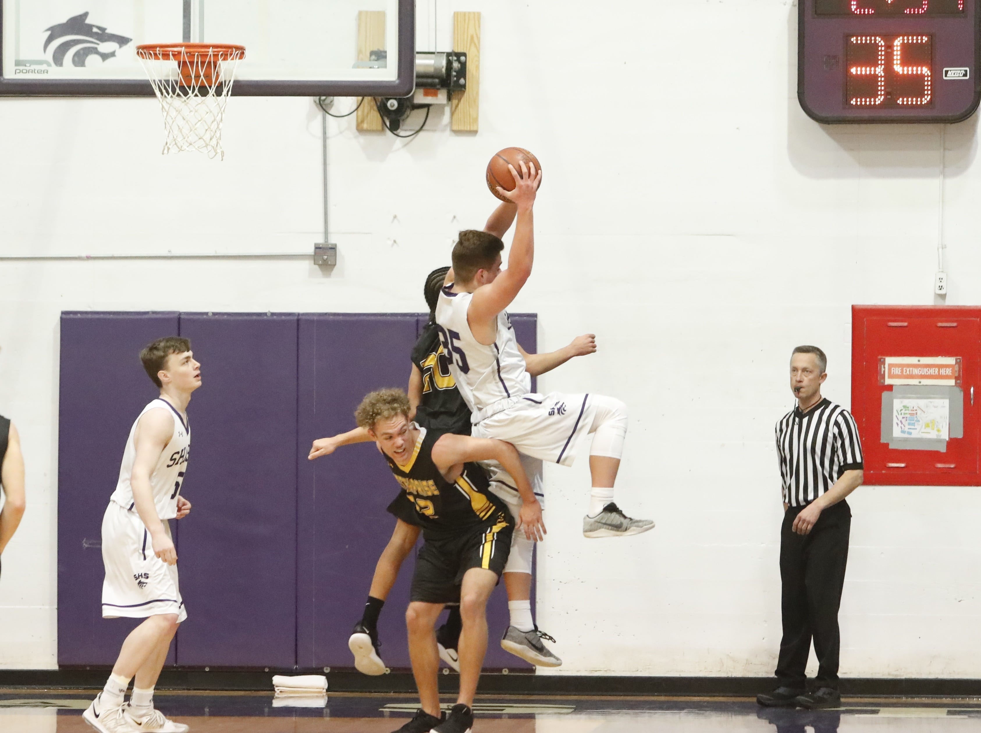 Shasta forward Simon Turner grabs a rebound over Enterprise's Leslie Cummings during the Wolves' league win.