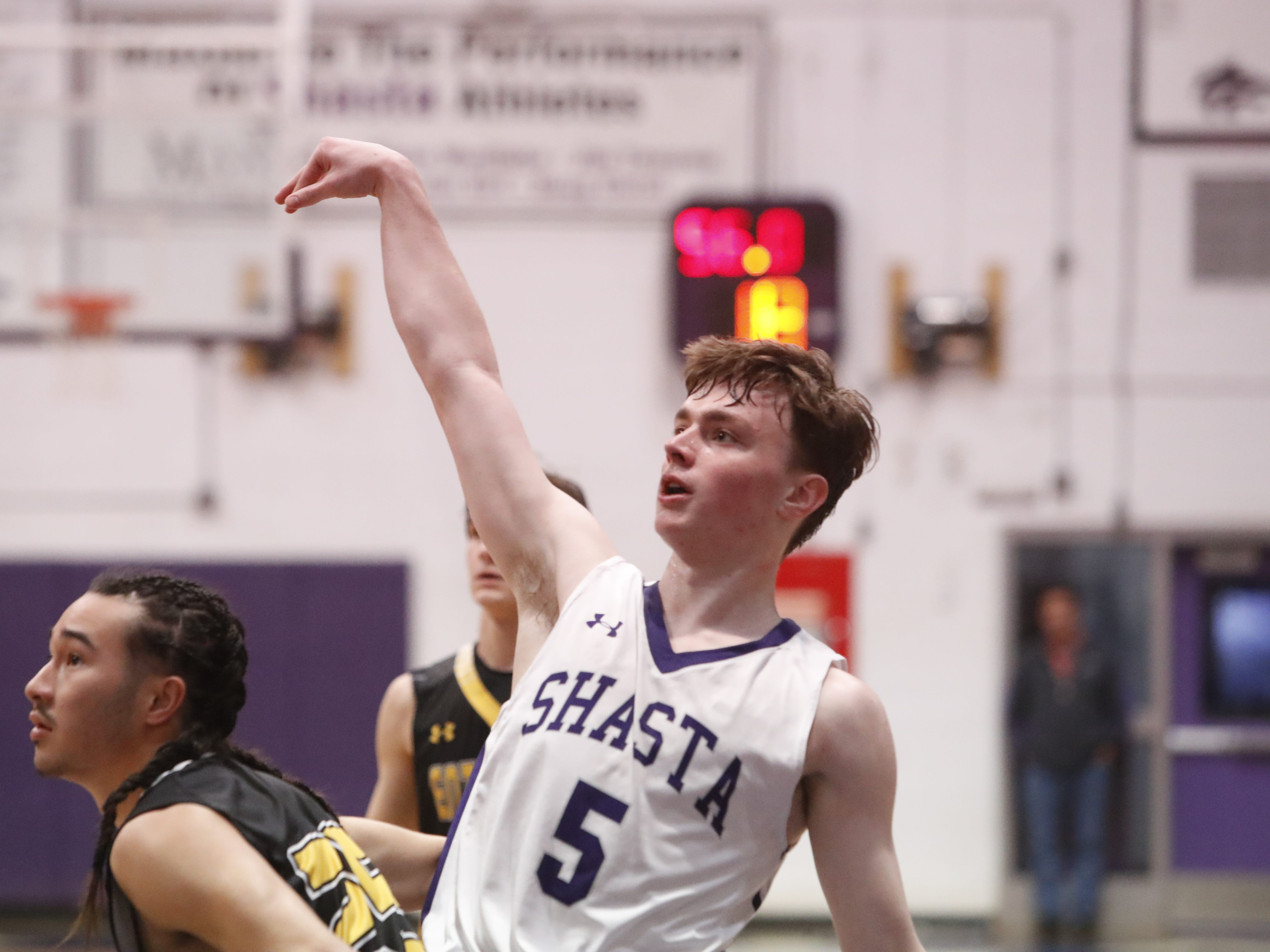 Shasta guard Caden Cushman follows through on a jump shot during the Wolves' 75-58 win over Enterprise on Tuesday, Feb. 5, 2019.