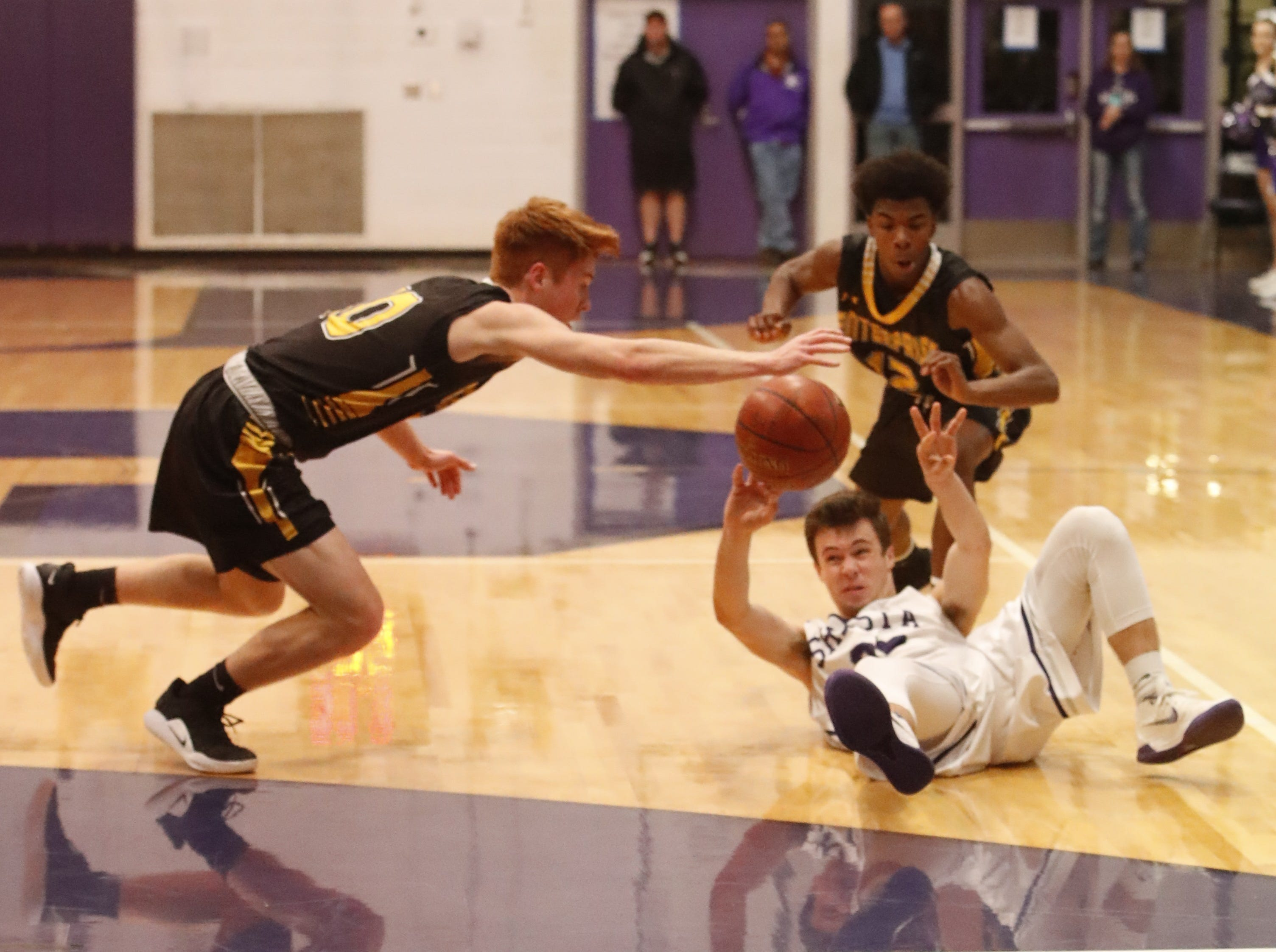 Shasta and Enterprise players scramble for the ball during the second half of a league game on Tuesday, Feb. 5, 2019.