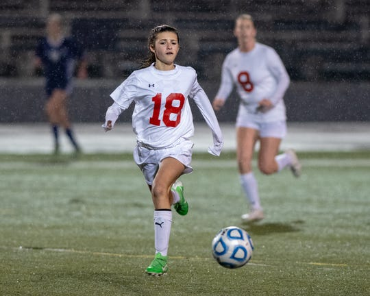 Foothill freshman Peyton Jackson chases the ball during a 1-0 loss to Shasta on Feb. 1, 2019.