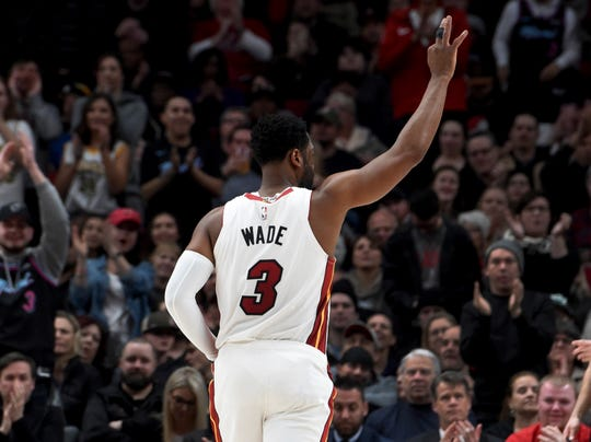 Miami Heat guard Dwyane Wade acknowledges the crowd as he enters during the first half of the team's NBA basketball game against the Portland Trail Blazers in Portland, Ore., Tuesday, Feb. 5, 2019. This will likely be his final game in Portland as he is set to retire at the end of the season.