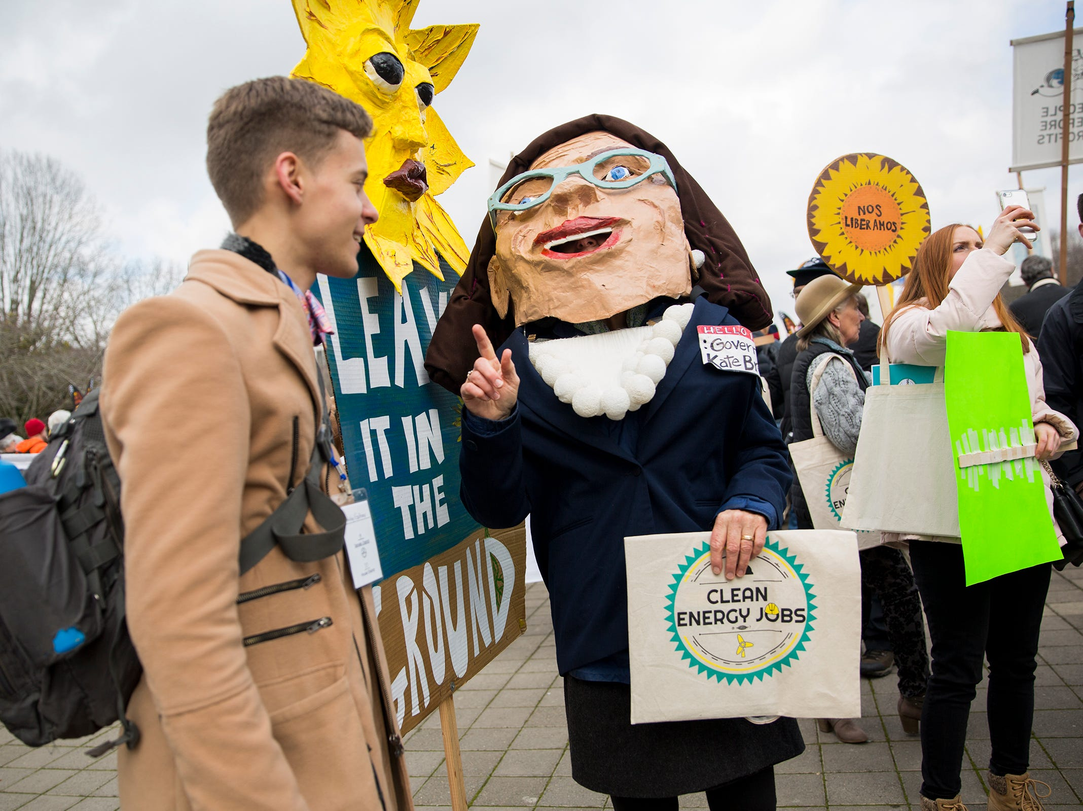Patricia Hine of Eugene dresses as Gov. Kate Brown at a  rally in support of clean energy jobs at the Oregon State Capitol in Salem on Wednesday, Feb. 6, 2019.
