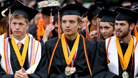 Graduates attend the Sprague High School commencement at Sprague High School on Friday, June 8, 2018.
