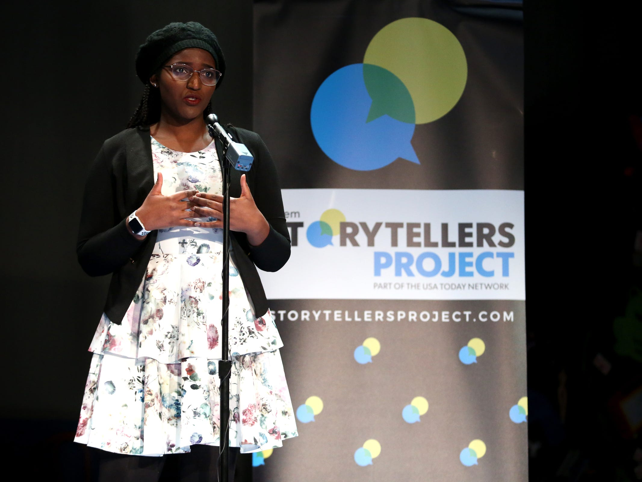 Divine Irambona speaks as Salem Storytellers Project presents Romance, or Not at the Pentacle Theatre in Salem on Tuesday, Feb. 5, 2019.