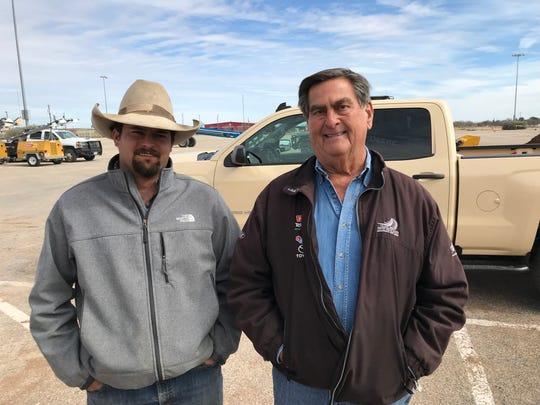 From left: Reece and Richard Albert share their extensive knowledge about dirt work with volunteers at the San Angelo Rodeo on Friday, Feb. 1, 2019.