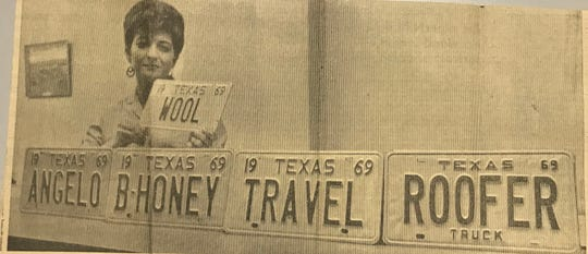 Evelyn Vordick, then car-license agent for the Tom Green County tax office, holds the plate destined for the new car the newly-crowned Miss Wool will drive. Vanity plates were a new idea, and cost an extra $10 in 1969.