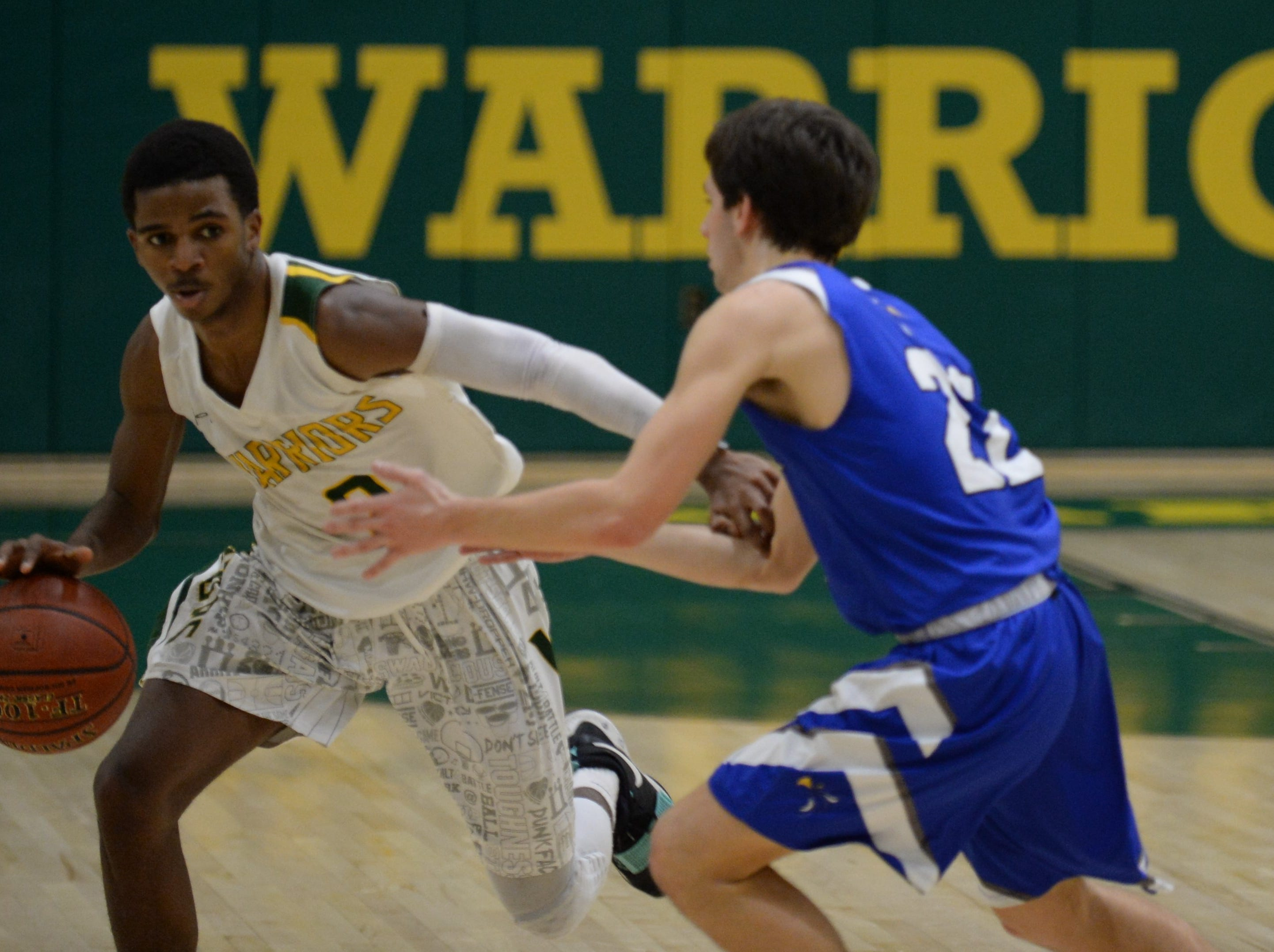 Mardela's Jarren Smith dribbles against Stephen Decatur's Brett Berquist on Tuesday, Feb. 5, 2019.