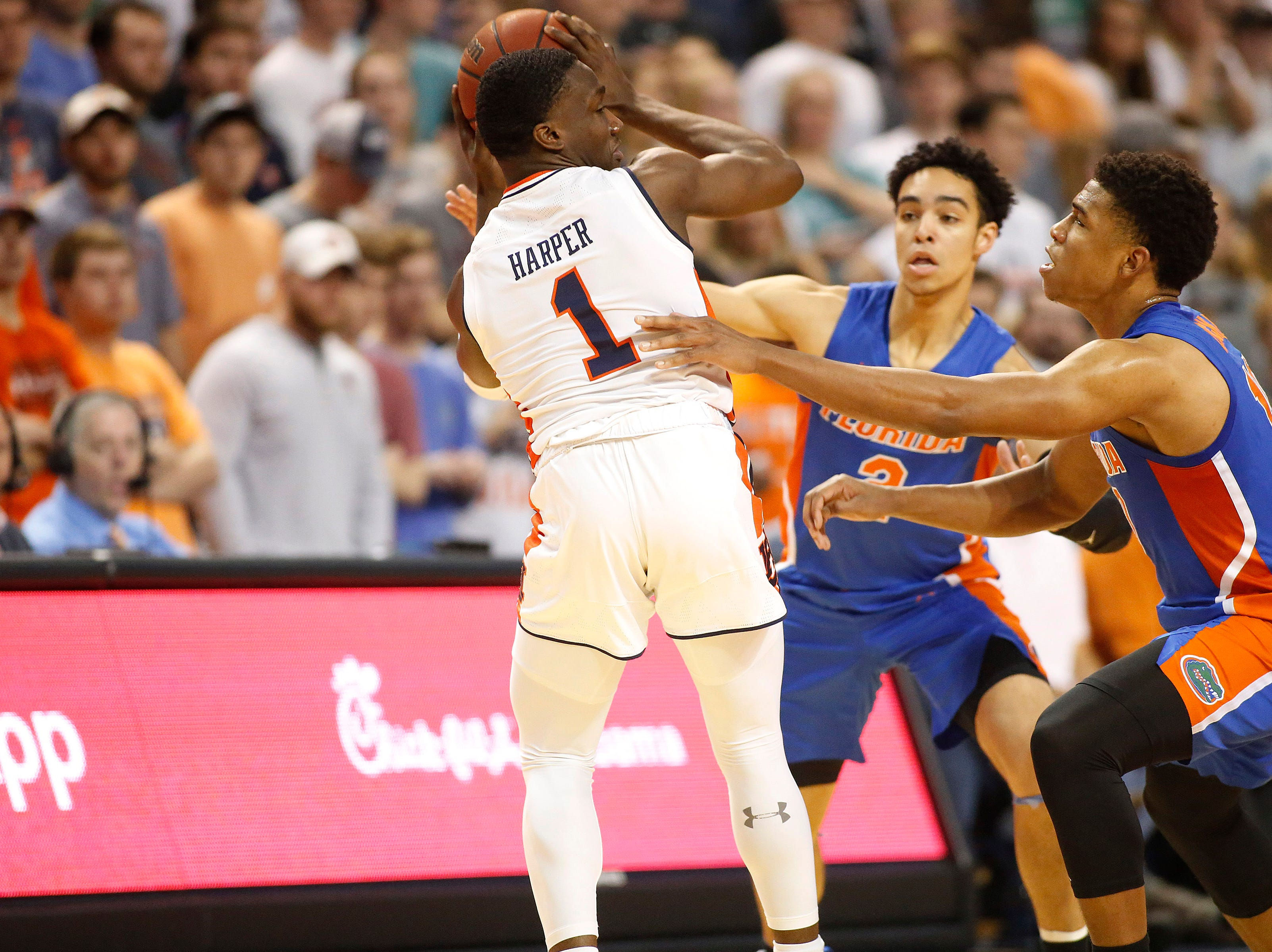 Feb 5, 2019; Auburn, AL, USA; Auburn Tigers guard Jared Harper (1) is surrounded by Florida Gators guard Andrew Nembhard (2) and guard Noah Locke (10) during the first half at Auburn Arena. Mandatory Credit: John Reed-USA TODAY Sports