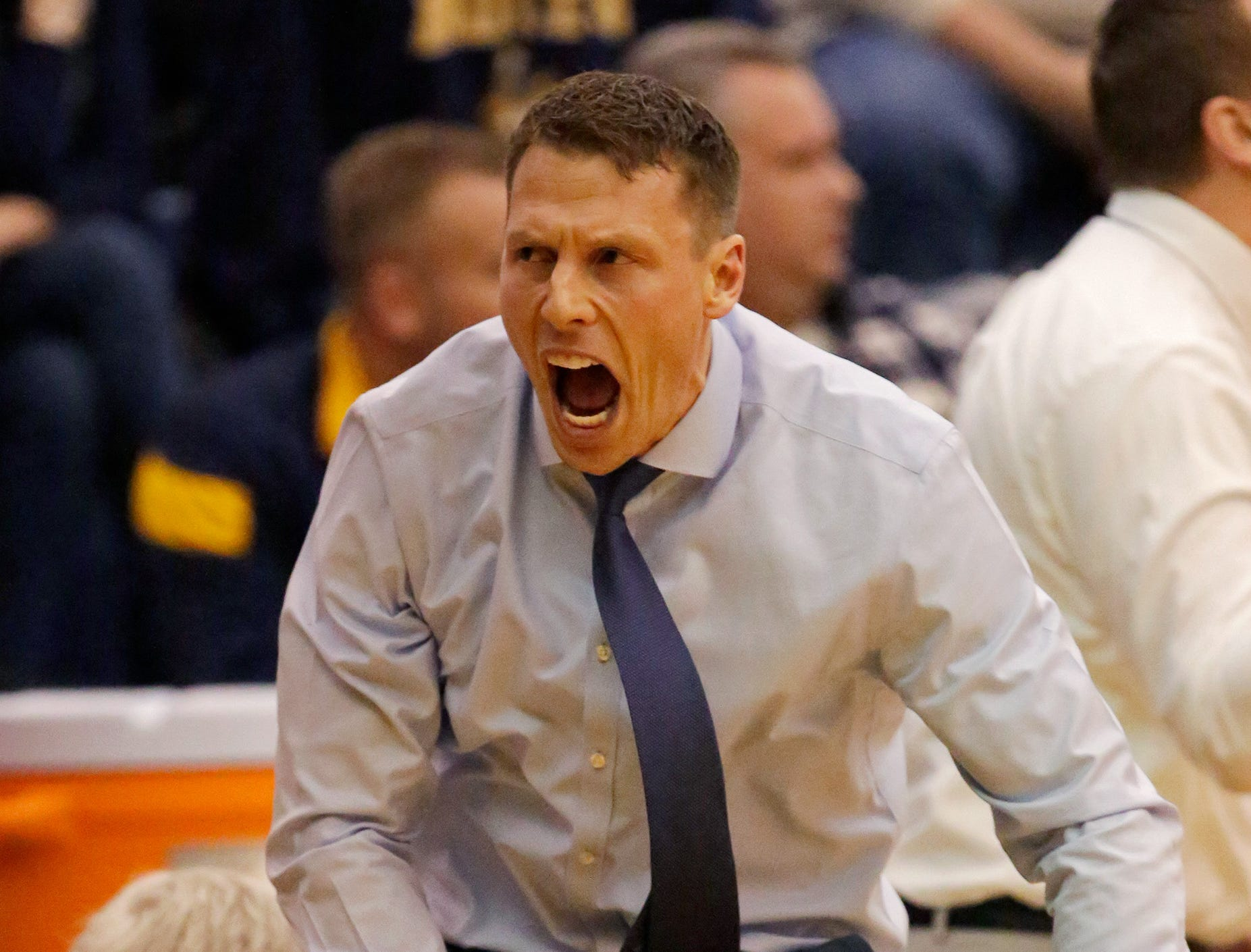 Sheboygan North coach Eric Worth leaps after North scores a three-point shot, Tuesday, February 5, 2019, in Sheboygan, Wis.