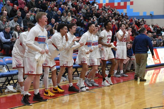 Lincoln players cheer during a game against Brandon Valley in Sioux Falls, S.D., Tuesday, Feb. 5, 2019.