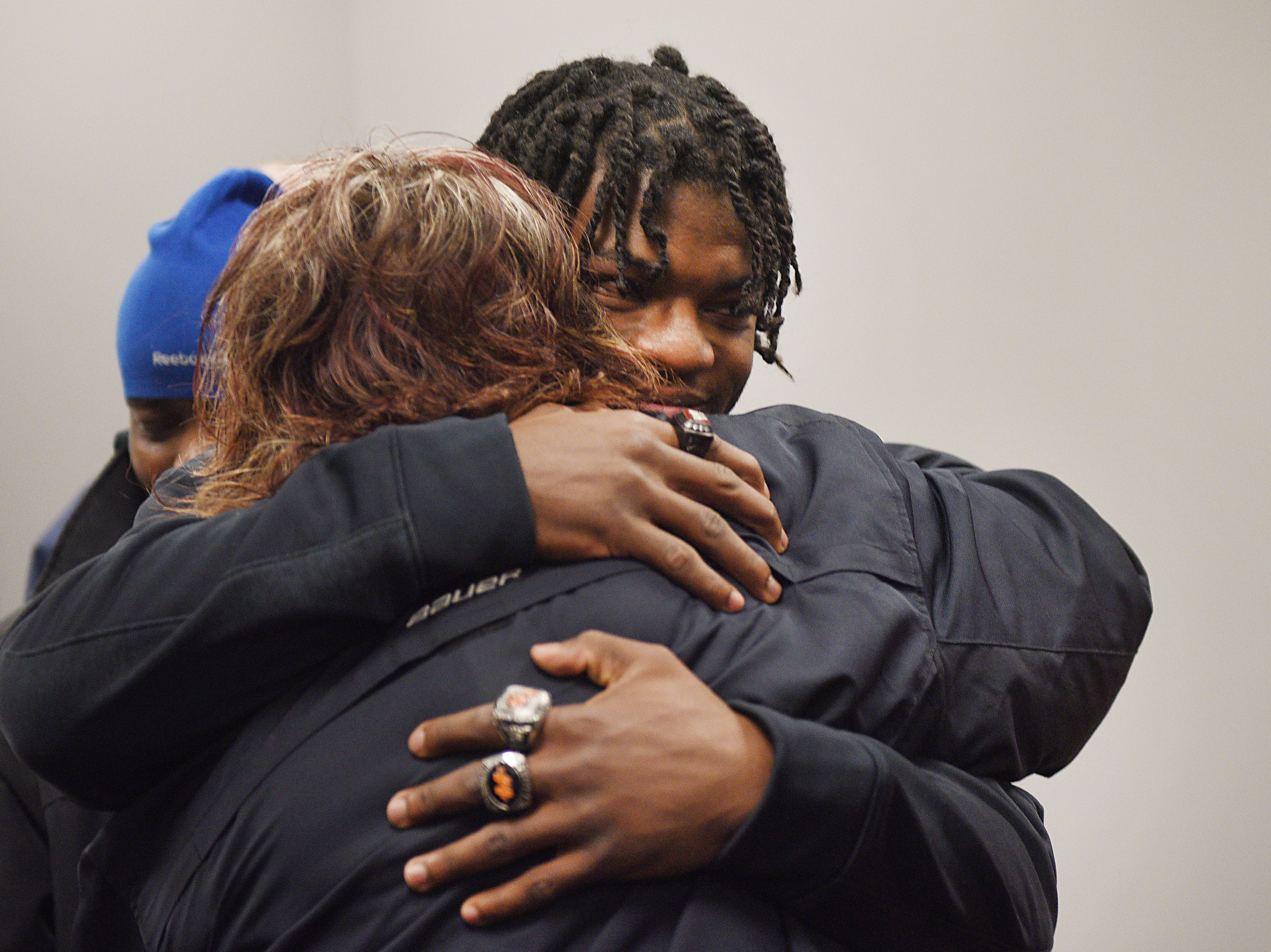 Washington's Tupak Kpeayeh hugs family friend Traci Hollingshead during signing day Wednesday, Feb. 6, at Avera Sports Institute in Sioux Falls. Kpeayeh singed a National Letter of Intent to play football at Morningside College.