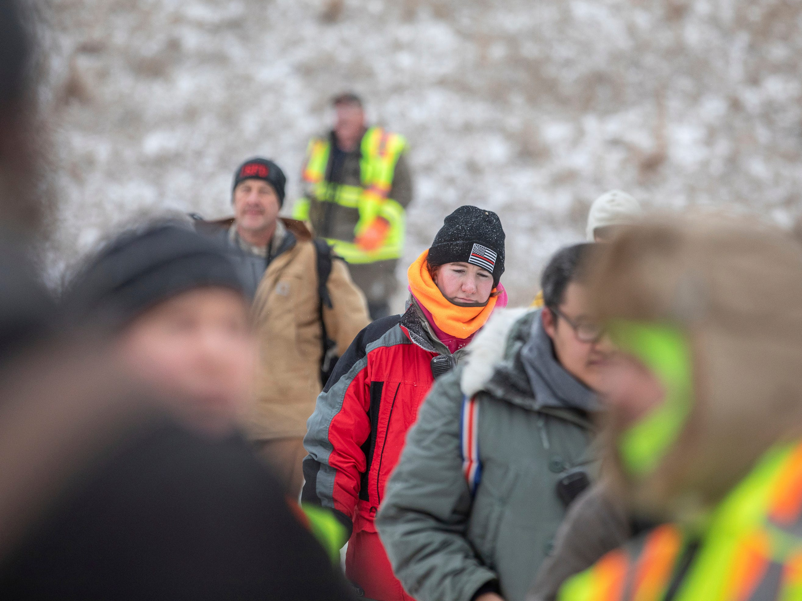 Searchers gather in a parking lot at the Black Hills Children's Home near Rockerville, S.D., on Tuesday, Feb. 5, 2019, after looking for Serenity Dennard, a 9-year-old girl who was last seen Sunday morning leaving the Children's Home. Officials are encouraging anyone living in the Rockerville, Foster Gulch and Highway 16 area to check their property. (Ryan Hermens/Rapid City Journal via AP)