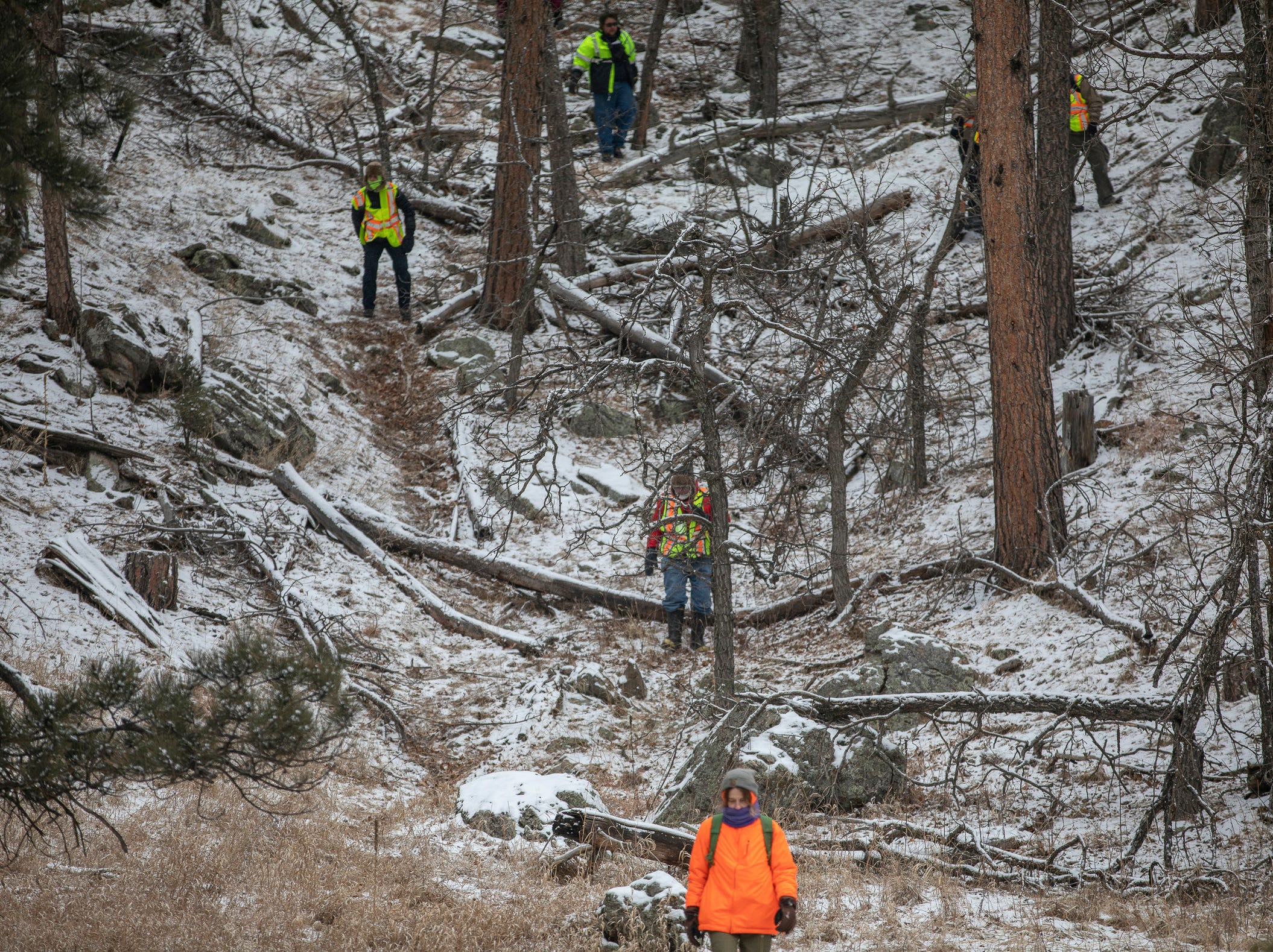 Searchers comb the area near the Black Hills Children's Home near Rockerville, S.D., on Tuesday, Feb. 5, 2019, while looking for Serenity Dennard, a 9-year-old girl who was last seen Sunday morning leaving the Children's Home. Officials are encouraging anyone living in the Rockerville, Foster Gulch and Highway 16 area to check their property. (Ryan Hermens/Rapid City Journal via AP)