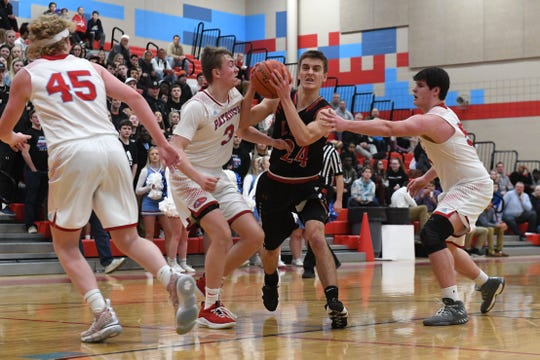 Brandon Valley's Evan Talcott (24) dribbles the ball past Lincoln players during a game in in Sioux Falls, S.D., Tuesday, Feb. 5, 2019.