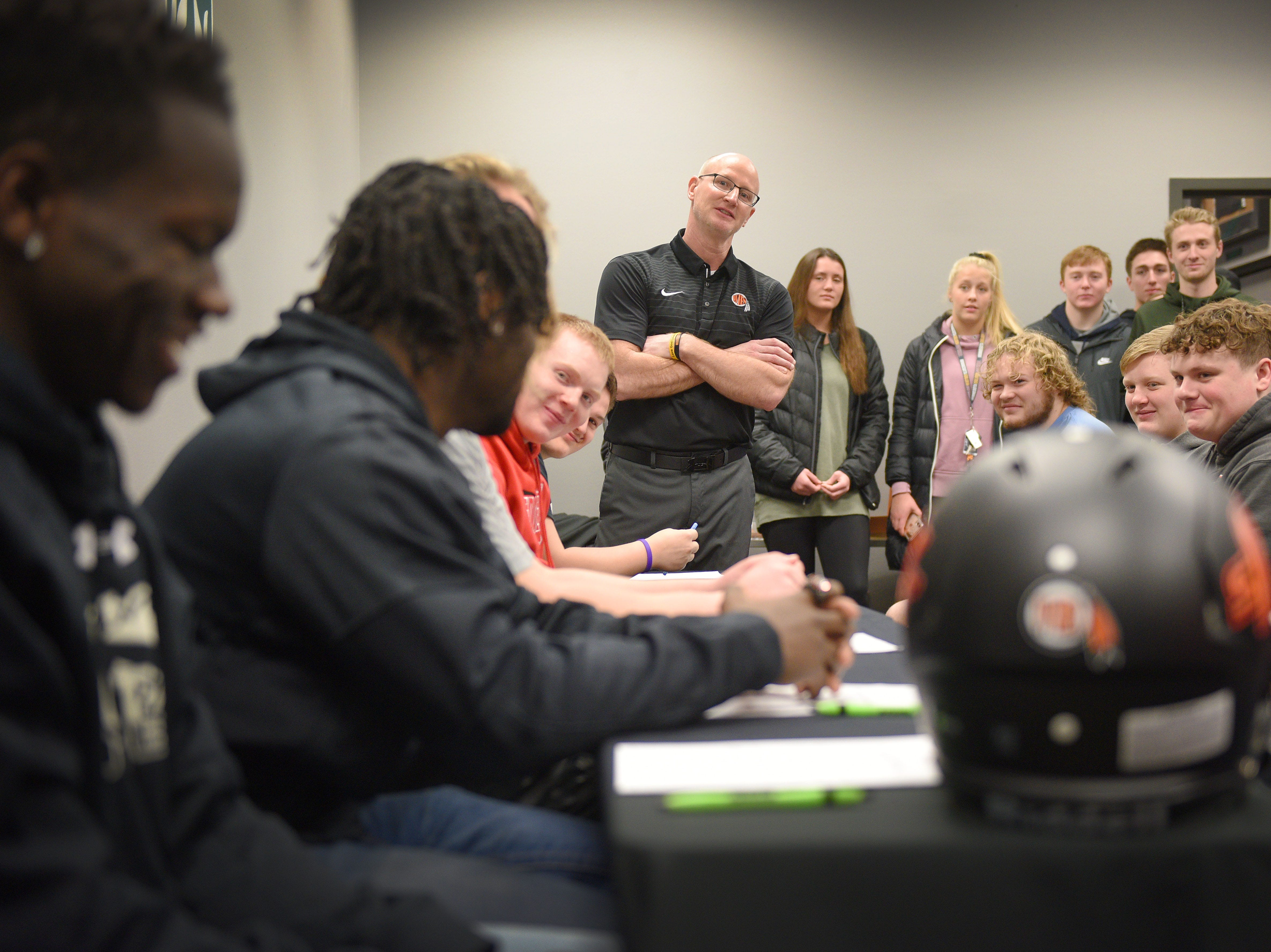 Washington head coach Chad Stadem crakes a joke to Tupak Kpeayeh during Washington High School signing day Wednesday, Feb. 6, at Avera Sports Institute in Sioux Falls. Kpeayeh singed a National Letter of Intent to play football at Morningside College.