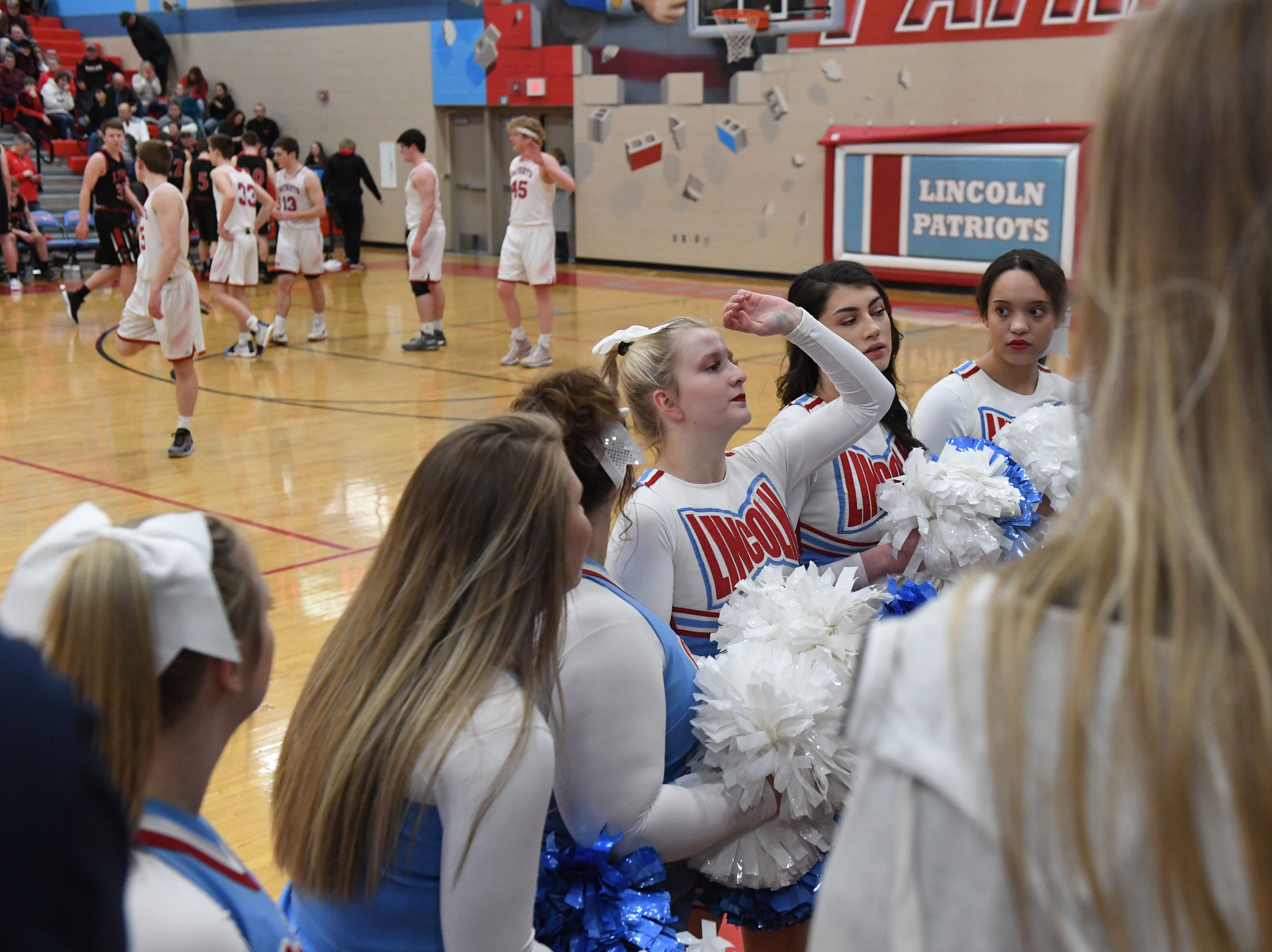 Lincoln cheerleaders engage with the crowd during a game against Brandon Valley in Sioux Falls, S.D., Tuesday, Feb. 5, 2019.