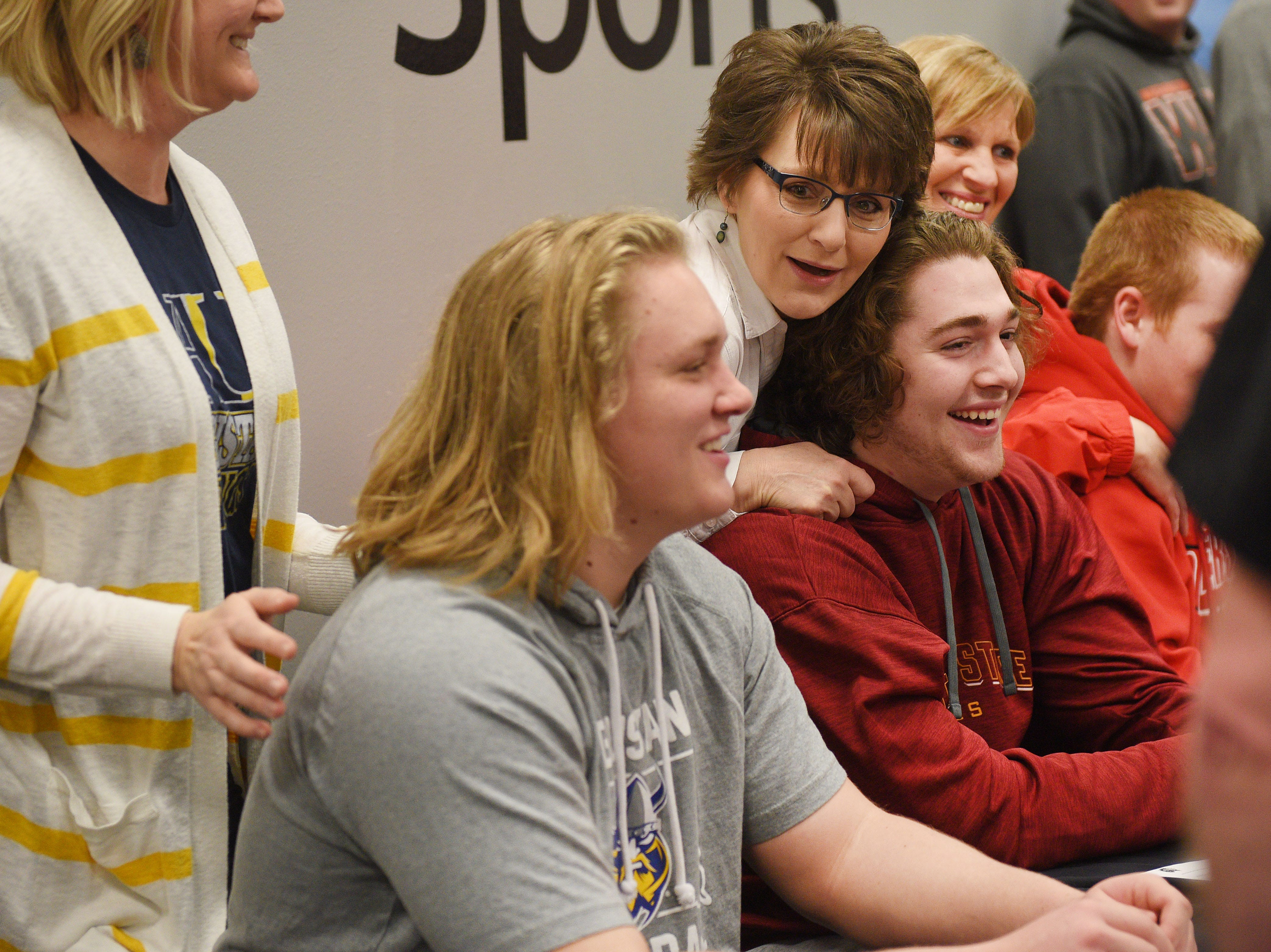Deb Durland, center, stands behind her son Adam Durland for a photo on signing day for Washington High School Wednesday, Feb. 6, at Avera Sports Institute in Sioux Falls. Durland singed a National Letter of Intent to play football at Northern State University.