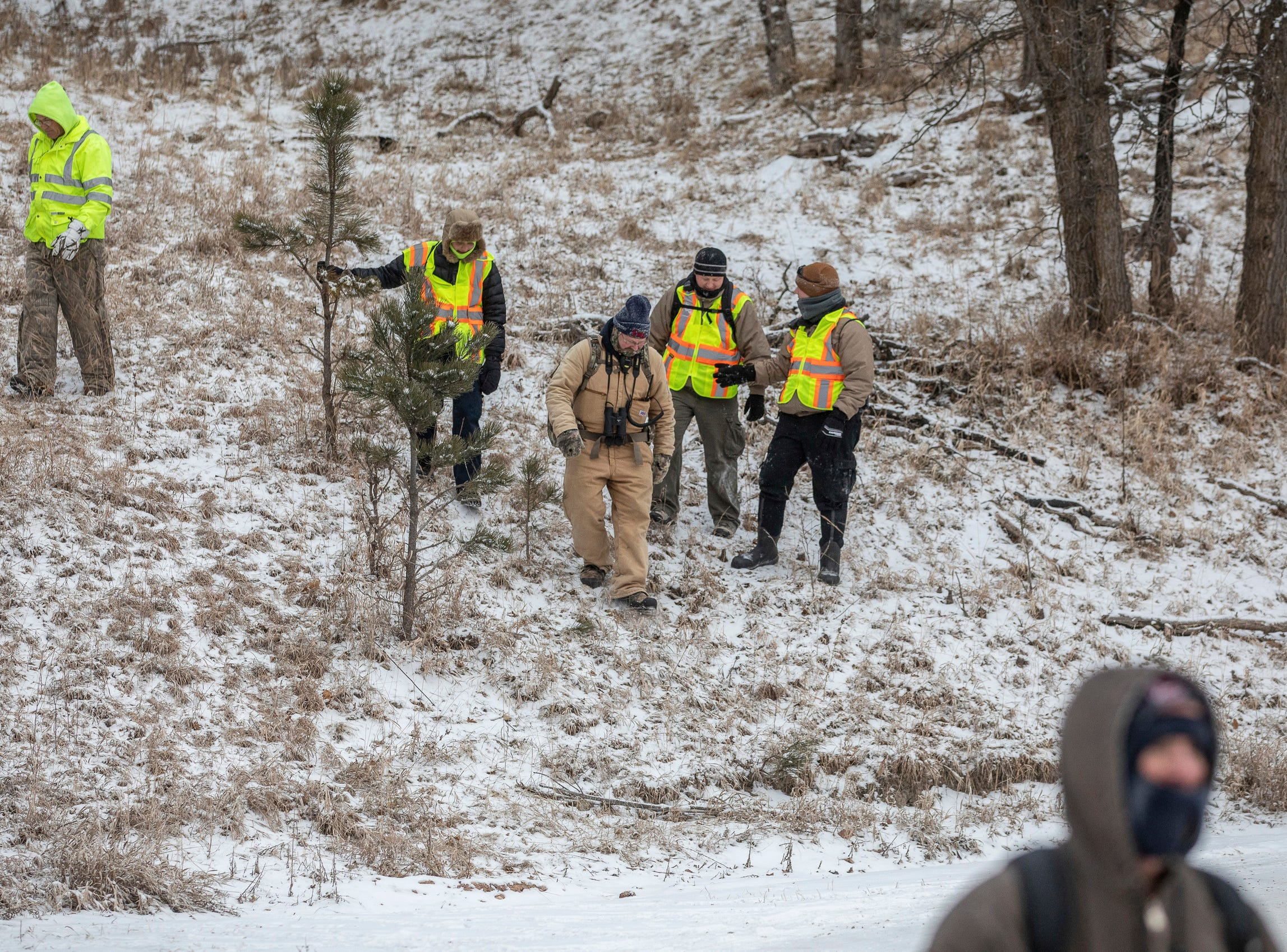 Searchers return to a parking lot at the Black Hills Children's Home near Rockerville, S.D., on Tuesday, Feb. 5, 2019, after looking for Serenity Dennard, a 9-year-old girl who was last seen Sunday morning leaving the Children's Home. Officials are encouraging anyone living in the Rockerville, Foster Gulch and Highway 16 area to check their property. (Ryan Hermens/Rapid City Journal via AP)
