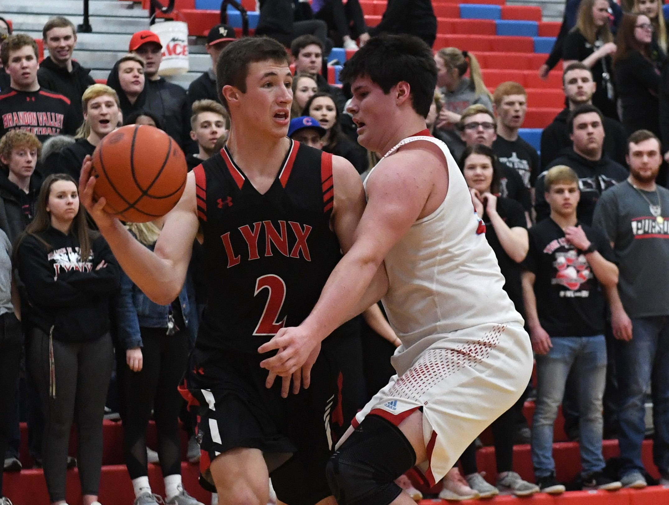 Brandon Valley's Carter Olthoff (2) looks to pass the ball during a game against Lincoln in Sioux Falls, S.D., Tuesday, Feb. 5, 2019.