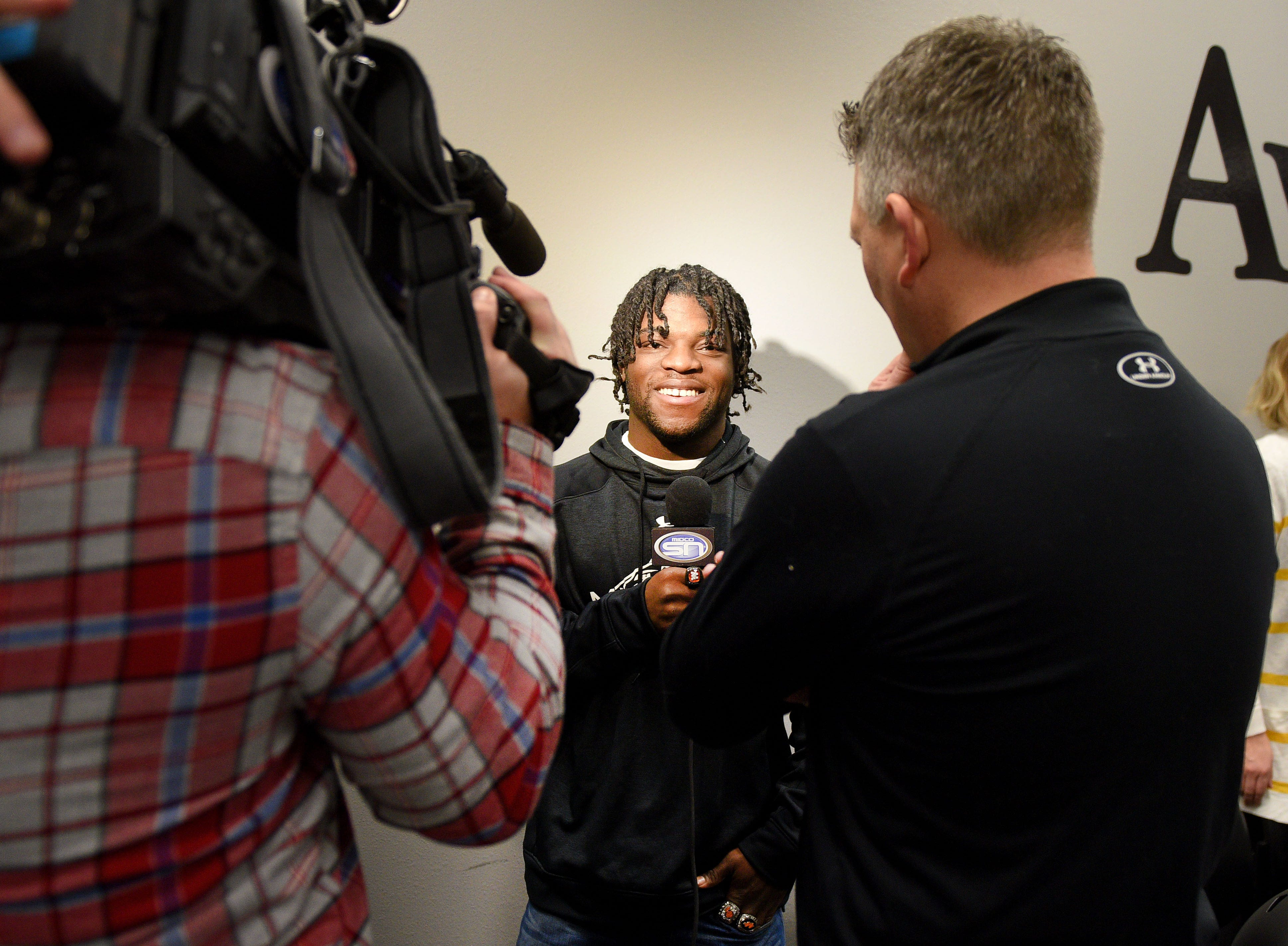 Washington's Tupak Kpeayeh gives interviews during signing day Wednesday, Feb. 6, at Avera Sports Institute in Sioux Falls. Kpeayeh singed a National Letter of Intent to play football at Morningside College.