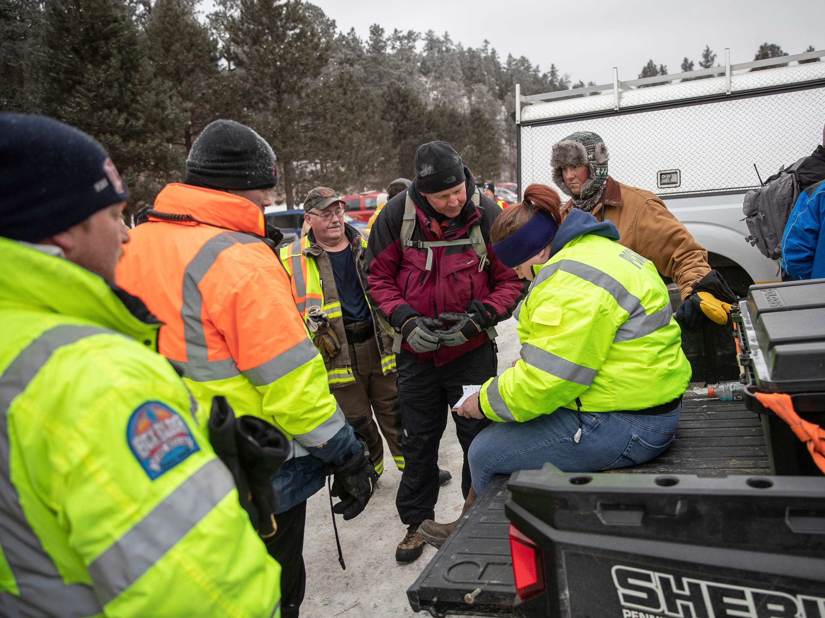 Searchers gather in a parking lot at the Black Hills Children's Home near Rockerville, S.D., on Tuesday, Feb. 5, 2019, after helping to look for Serenity Dennard, a 9-year-old girl who was last seen Sunday morning leaving the Children's Home. Officials are encouraging anyone living in the Rockerville, Foster Gulch and Highway 16 area to check their property. (Ryan Hermens/Rapid City Journal via AP)