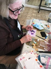 Carolyn Baker of the Great Plains Watercolor Society makes Valentine's Day cards for the Dell Rapids and Sioux Falls Meals on Wheels program.