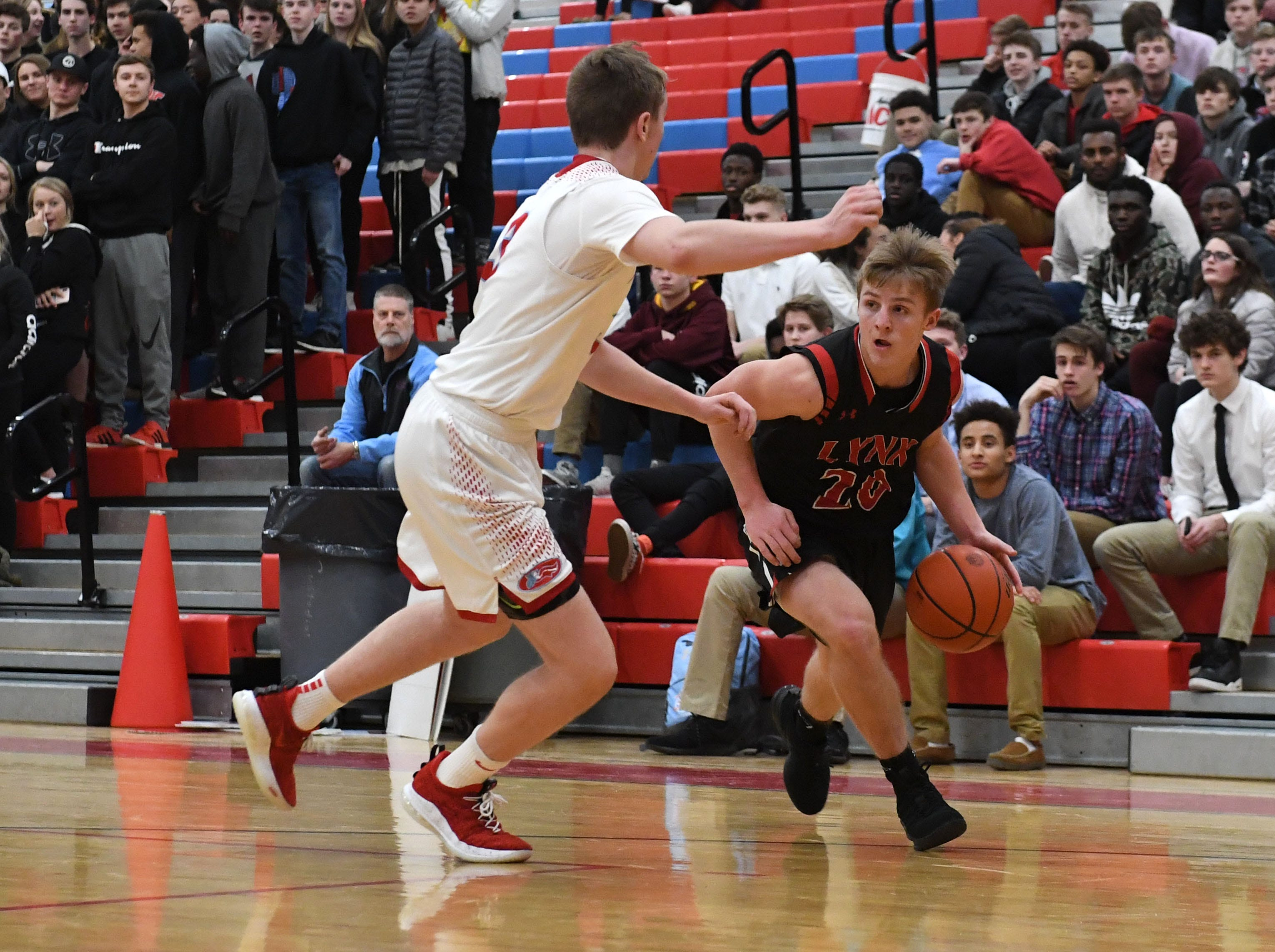Brandon Valley's Joe Kolbeck (20) dribbles the ball past Lincoln player during a game in Sioux Falls, S.D., Tuesday, Feb. 5, 2019.