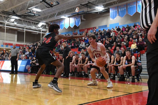 Brandon Valley's Jackson Hilton (34) blocks Lincoln's Jared Jaros (13) during a game in Sioux Falls, S.D., Tuesday, Feb. 5, 2019.