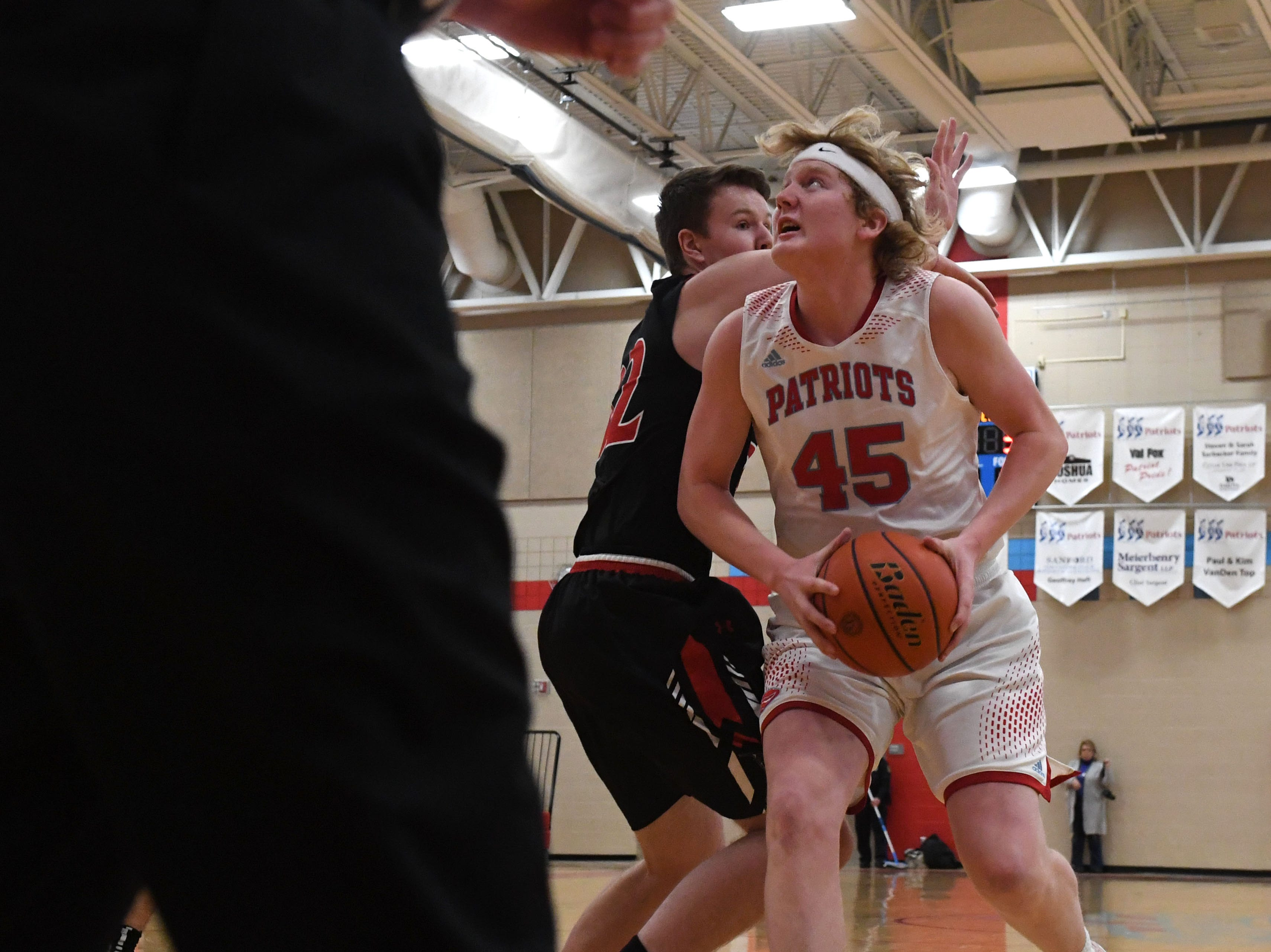 Lincoln's Nate Brecht (45) dribbles the ball past Brandon Valley's Alex Tietjen (32) during a game in Sioux Falls, S.D., Tuesday, Feb. 5, 2019.