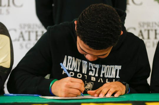 Tyson Riley signs his letter of intent to play football at Army.