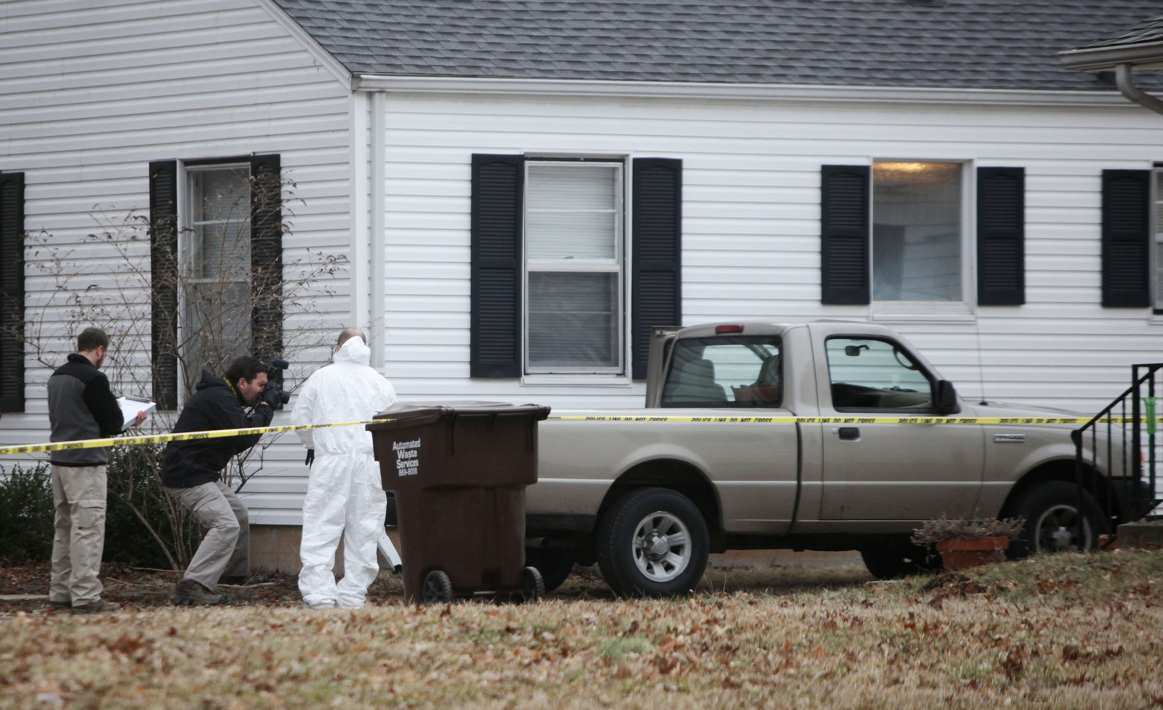 Authorities collect evidence at Craig Wood's home on Stanford Street in February 2014.